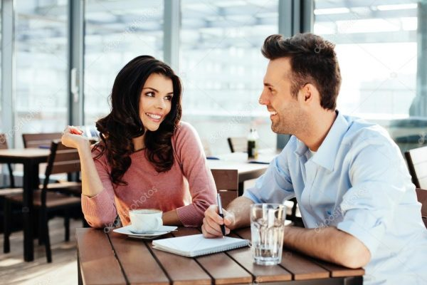 depositphotos_68814091-stock-photo-couple-discussing-and-writing-down