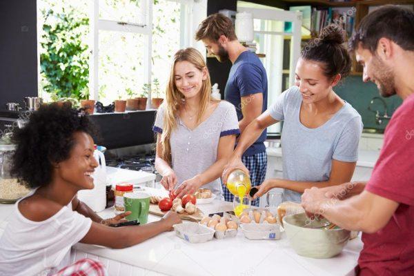 depositphotos_98177764-stock-photo-friends-cooking-breakfast-in-kitchen