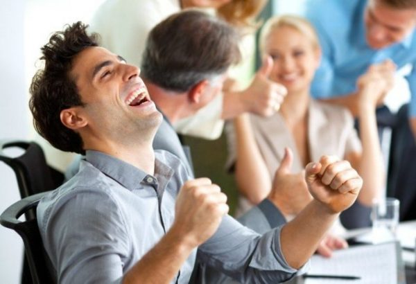 guy-celebrating-at-work-istock_000022333352_small-1-635x434